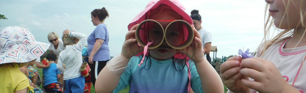 Girl with homemade binoculars
